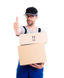 Friendly postman with parcels and thumb up Stock Photography