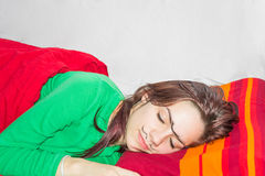 Friendly prank. Sleeping girl with hand drawn mono eyebrow and moustache on her face Royalty Free Stock Photos