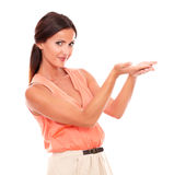 Friendly pretty woman holding palms up Royalty Free Stock Photography
