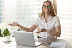 Friendly receptionist invites visitors on meeting royalty free stock images