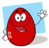 Friendly red easter egg character waving Stock Image