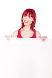 Friendly Redhead With Blank Banner Royalty Free Stock Photography