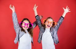 Friendly relations siblings. Sincere cheerful kids share happiness and love. Girls funny big eyeglasses cheerful smile royalty free stock photos