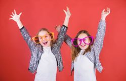 Friendly relations siblings. Sincere cheerful kids share happiness and love. Girls funny big eyeglasses cheerful smile. Birthday party. Happy childhood. Joyful stock photos