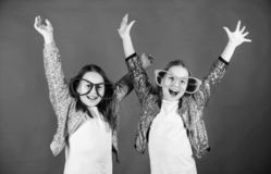 Friendly relations siblings. Sincere cheerful kids share happiness and love. Girls funny big eyeglasses cheerful smile. Birthday party. Happy childhood. Joyful stock photography