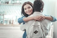 Delighted positive woman hugging her friend Royalty Free Stock Photo
