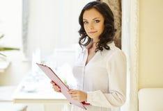 Friendly restaurant hostess posing at camera Stock Photo
