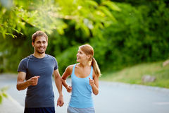 Friendly runners Stock Images