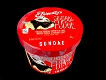 Friendly`s Individual Ice Cream Sundae. On a black backdrop royalty free stock photos