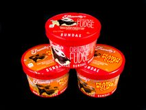 Friendly`s Individual Ice Cream Sundae`s. On a black backdrop stock photography