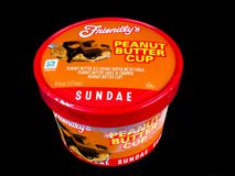 Friendly`s Individual Peanut Butter Cup Ice Cream Sundae. Friendly`s Individual Ice Cream Sundae on a black backdrop stock image