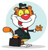 Friendly salesman tiger waving and carrying a brie Stock Photos