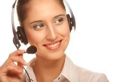 Friendly secretary. Portrait of friendly secretary/telephone operator wearing headset Royalty Free Stock Photos