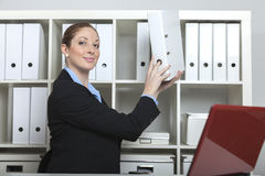 Friendly secretary takes a folder Royalty Free Stock Image