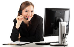 A friendly secretary/telephone operator in headphones, white bac Stock Image