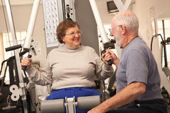 Friendly Senior Adult Couple Working Out Together in the Gym Royalty Free Stock Images