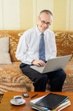 Friendly Senior Businessman with Computer Royalty Free Stock Photography
