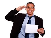 Friendly senior businessman greeting Stock Photo