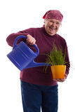 Friendly senior holding a watering can Royalty Free Stock Images