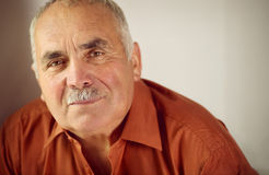 Friendly senior man with a moustache Stock Images