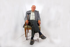 Friendly senior man sitting in his Royalty Free Stock Photo