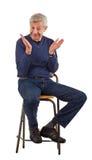 Friendly senior man smiles and claps Stock Photos