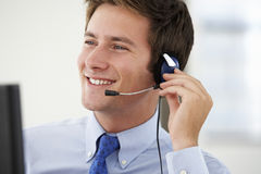 Friendly Service Agent Talking To Customer In Call Centre Stock Images