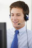 Friendly Service Agent Talking To Customer In Call Centre Royalty Free Stock Photography