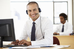 Free Friendly Service Agent Talking To Customer In Call Centre Stock Image - 54970241