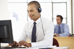 Free Friendly Service Agent Talking To Customer In Call Centre Stock Images - 54971044