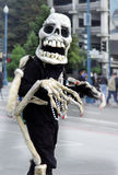 Friendly skeleton. Skeleton waking on the street stock photography