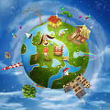 Friendly small Planet. A spring day on planet Earth: a green cartoon world with houses, flowers,sea, trees ,clouds Stock Image