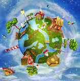 Friendly small Planet. A spring day on planet Earth: a green cartoon world with houses, flowers,sea, trees ,clouds Royalty Free Stock Image