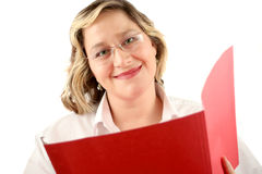 Friendly smile. Friendly smiling woman with file folder that could be a doctor or a businesswoman Royalty Free Stock Photo