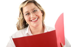 Friendly smile. Friendly smiling woman with file folder that could be a doctor or a businesswoman Royalty Free Stock Image