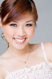 Friendly Smile. Beautiful asian woman smiling happily Stock Photos