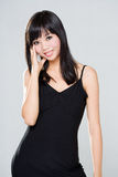 Friendly smile of asian woman. With long black hair  in black dress Royalty Free Stock Photo