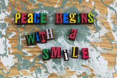 Peace begins with smile love stock photos