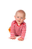 Friendly smiling baby. In red and white stripes Stock Images