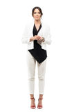 Friendly smiling business female presenter in formal suit with hands clasped looking at camera Royalty Free Stock Photography