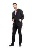 Friendly smiling businessman pointing finger hand gun sign towards camera Royalty Free Stock Images