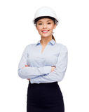 Friendly smiling businesswoman in white helmet Royalty Free Stock Photo