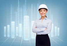 Friendly smiling businesswoman in white helmet Stock Images
