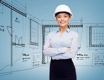 Friendly smiling businesswoman in white helmet Royalty Free Stock Photo