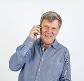 Friendly smiling man using the smart phone Royalty Free Stock Photo