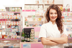 Friendly smiling medical worker  in front of her desk Royalty Free Stock Image