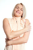 Friendly smiling middle-aged business woman isolated on white background Stock Photography