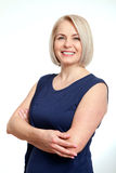 Friendly smiling middle-aged business woman  on white background Stock Photography