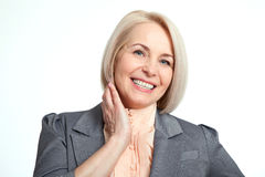 Friendly smiling middle-aged business woman  on white background Royalty Free Stock Images