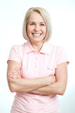 Friendly smiling middle-aged woman  on white background Royalty Free Stock Images